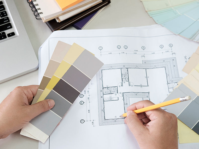 a person creating best interior design look with shade cards and layout