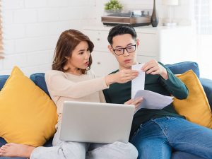 a couple borrowing payday loan from a licensed moneylender in singapore