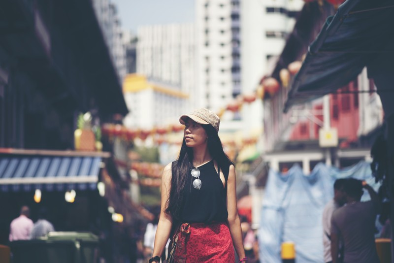 young woman looking for best moneylender providing payday loans in chinatown