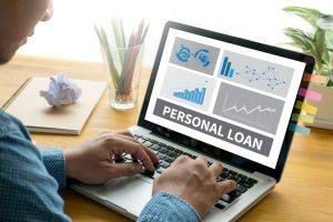 A consumer searching on laptop for the best cash loan or personal loan in Singapore